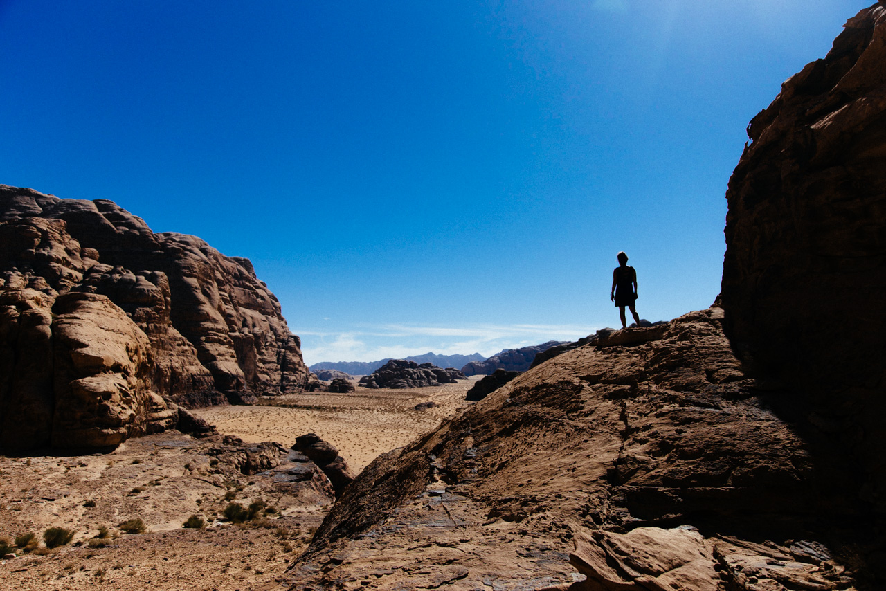 Sillhouetted woman overlooking a desert valley